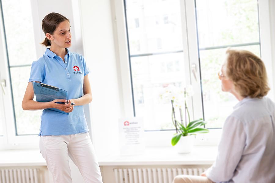 Nurse welcoming patient in waiting room